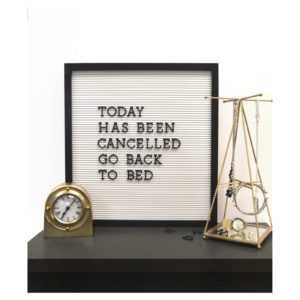 White letter board with black letters